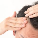 Man checking for thinning hair