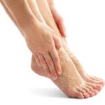 Woman using scrub on feet