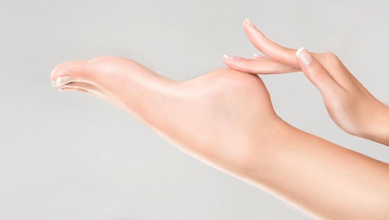 Woman touching soft feet